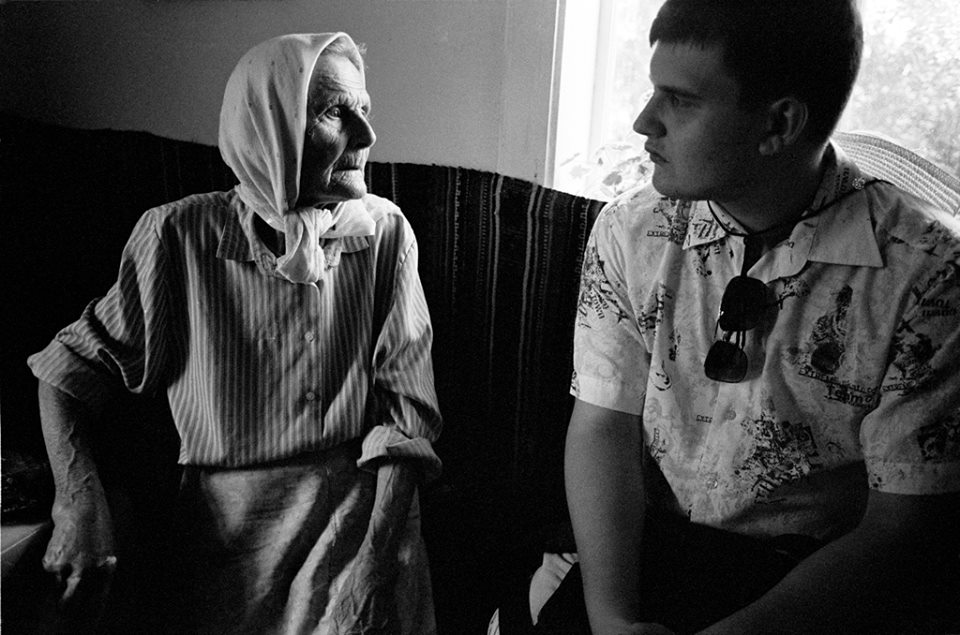 Ilia, a history major, interviews people in Nepolokivtsi, UA about their memories of WWII and the Jewish people who once lived here. 2013 ©Sylvia de Swaan