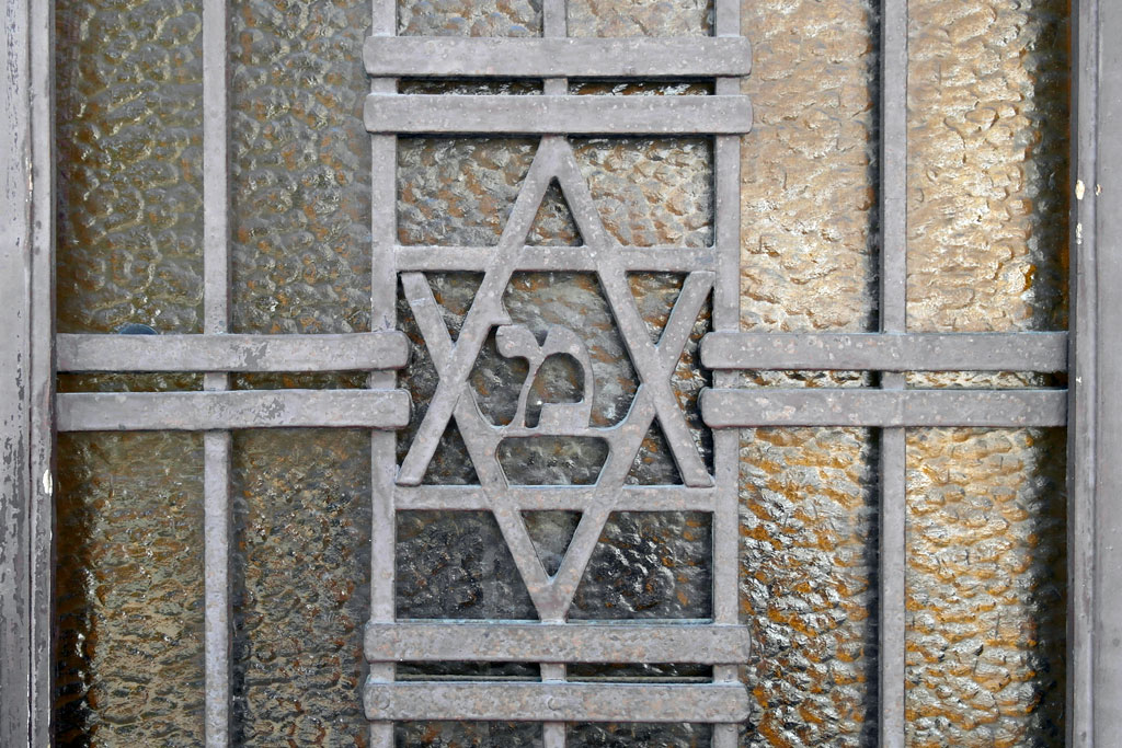 A forgotten blessing at the front door of a former synagogue
