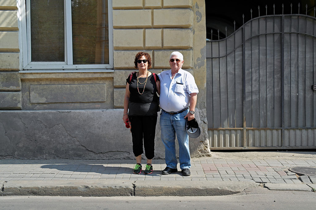 Arthur Rindner with his girlfriend Rina in front of the house where he was born