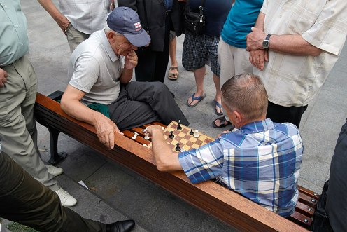 Old men playing chess at Svoboda Boulevard - a free pleasure