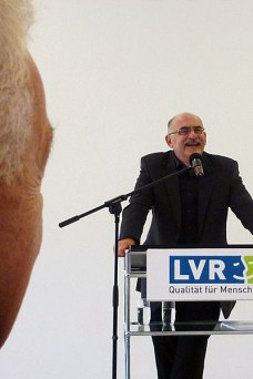 Exhibition opening, Cologne, September 17, 2014. Edgar Hauster speaking. Photo: Marion Tauschwitz