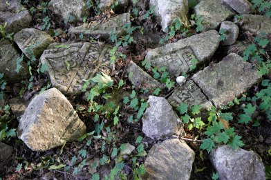 Fragments of gravestones at the site of the former Jewish cemetery