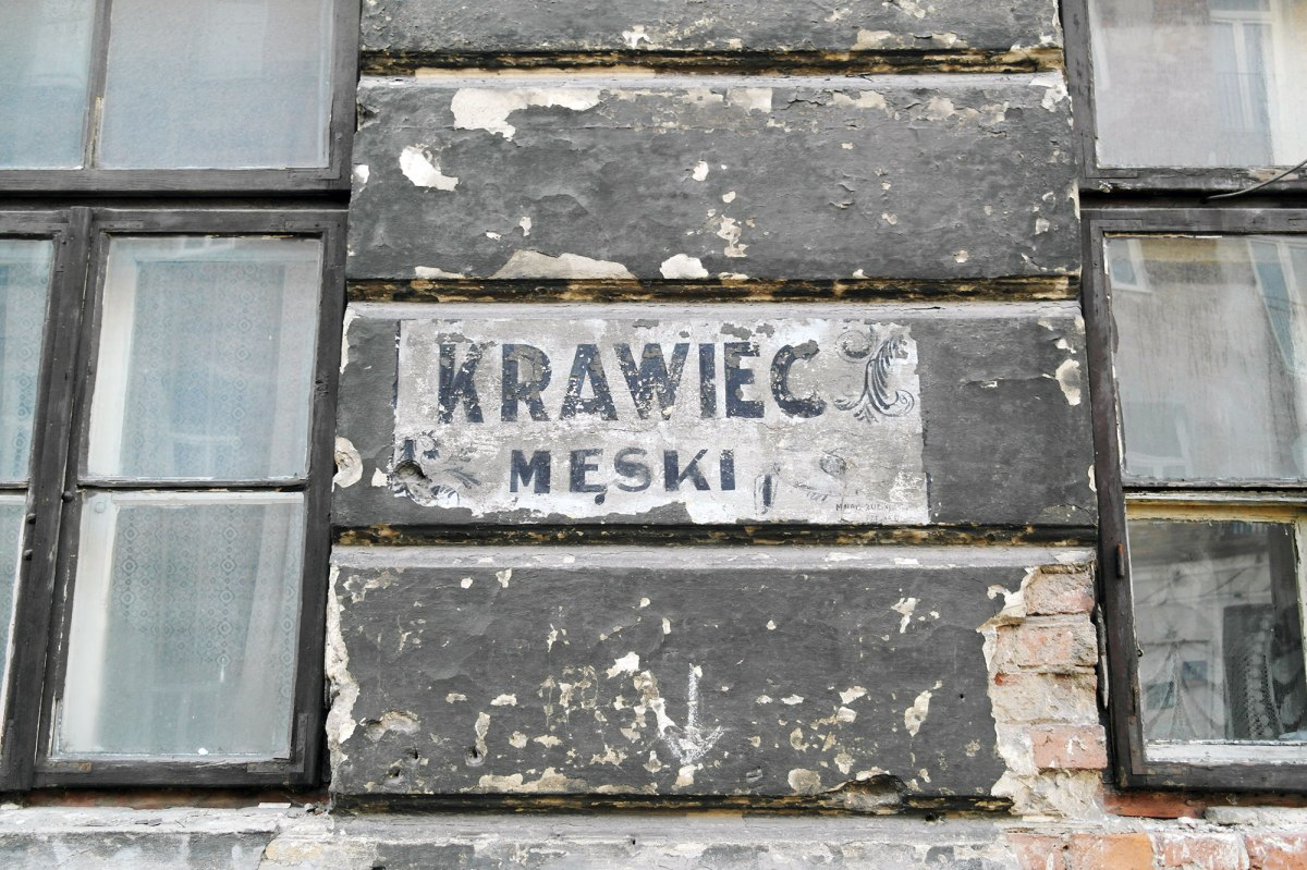 Warsaw - shop sign of a Jewish tailor in Praga