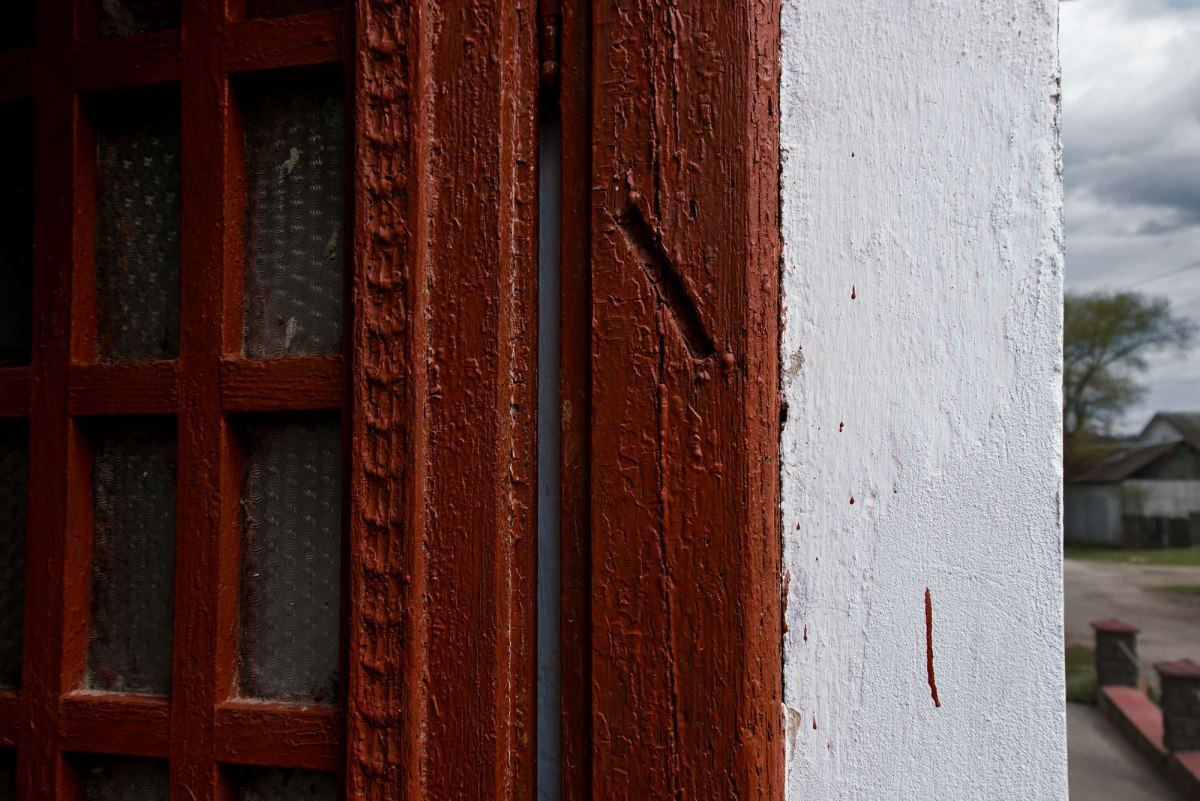 Pidhaitsi, Galicia in Ukraine - trace of a mezuzah at the door frame of house in the former Jewish quarter