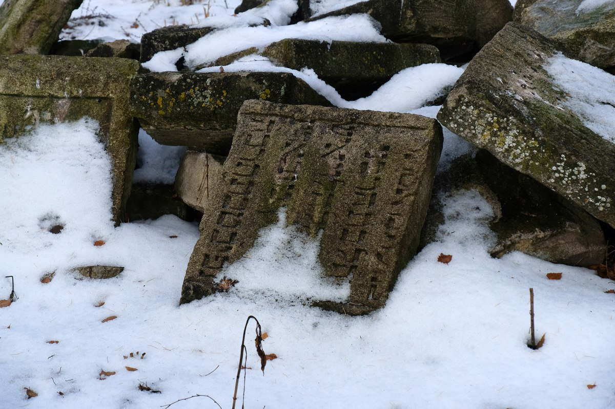 Skalat - returned Jewish tombstones at a mass grave site