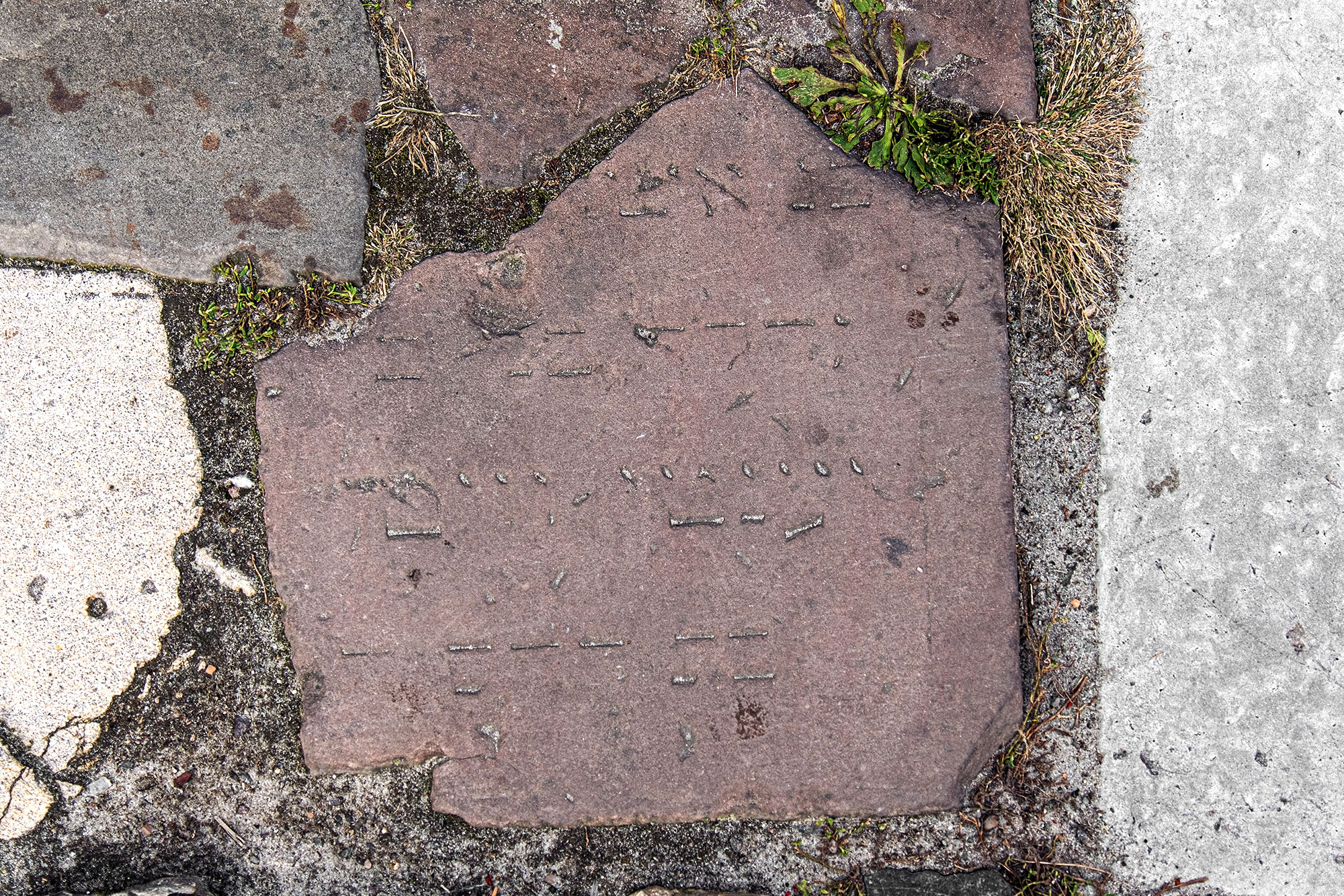 Lviv - fragment of a Jewish tombstone in the street paving